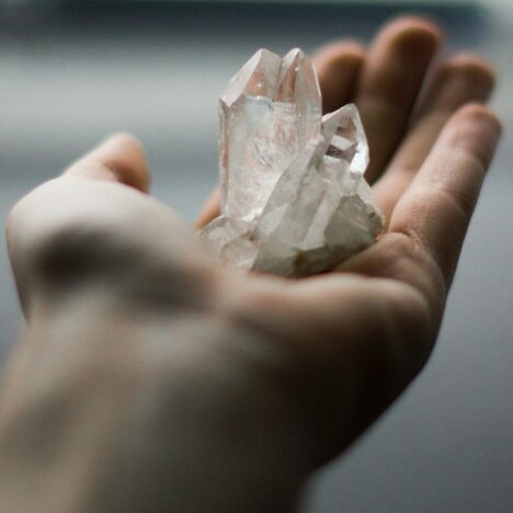 reiki, hand holding crystal